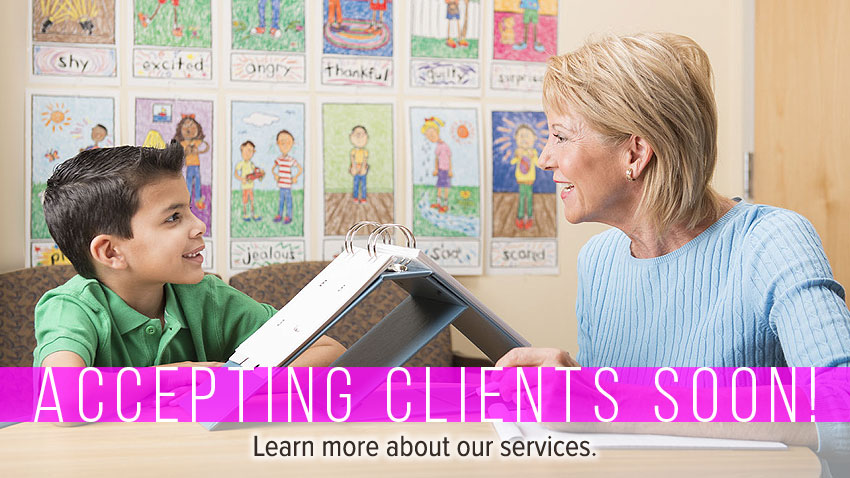 Woman administering assessment to boy at table. Text: Accepting Clients Soon. Learn more about our services.